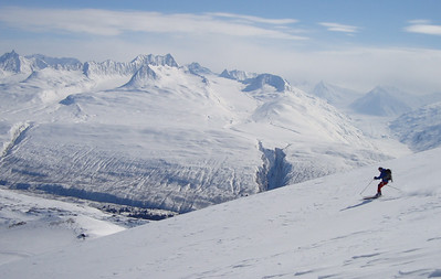 Fun turns with a view of the Heiden Glacier across the valley