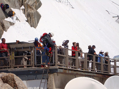 The final move of the Cosmiques Ridge climb, a ladder onto the observation deck of the tram station
