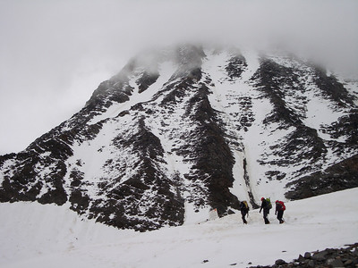 Approaching the the Gouter Hut (in the clouds) from the Tete Rousse Glacier