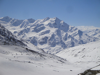 The distant view of all the ski terrain out of the Branca hut