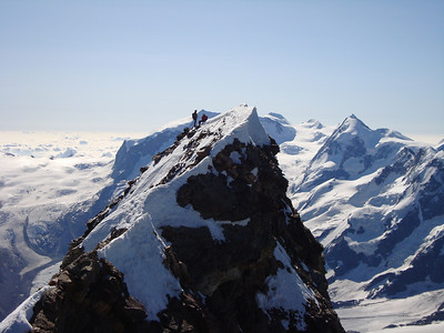 Another view of the Swiss summit with an American climber and her Scottish guide
