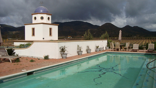 The swimming pool at the Adobe with the vineyards in the background