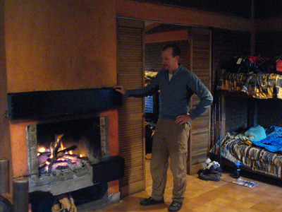 Relaxing around the fireplace at our private cabin.