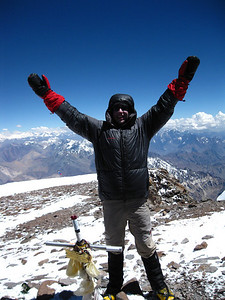 One of our International Guides enjoys the summit of Aconcagua.