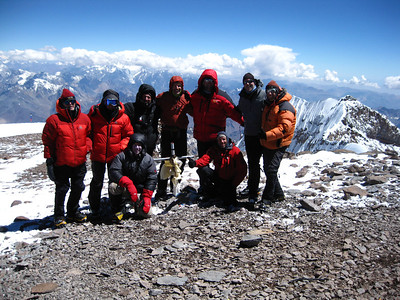 A recent summit team on top of South America.