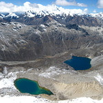 The summit of Ishinca shows us the endless mountains and alpine lakes of the Andes Mountains.