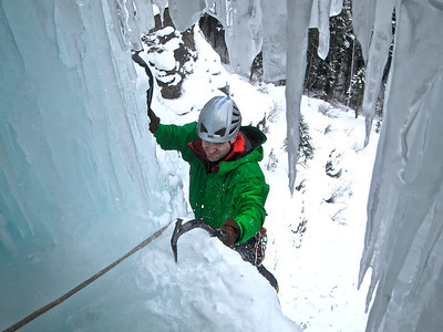 climbing into the ice cave on Carlsberg