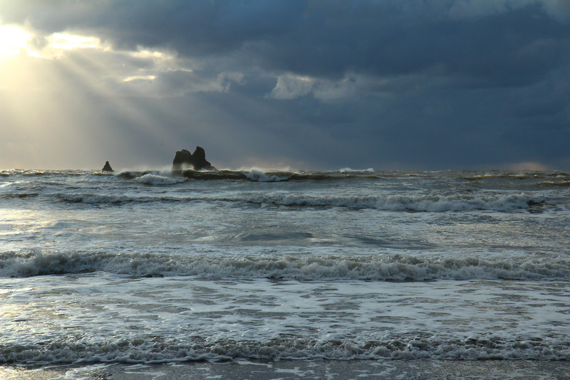 Streams of light crash down upon the waves at Second Beach, La Push, in the Quileute Nation.