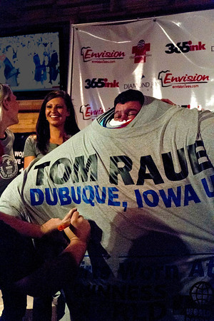 The most T-shirts worn at once is 247, was achieved by Tom Rauen (USA) in Dubuque, Iowa, USA, on 11 November 2011. Record has been surpassed.   All rights reserved Guinness World Records