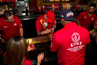 The most cocktails made in one hour is 1,559, achieved by Erik Mora (USA) at the Spearmint Rhino Gentleman's Club in Las Vegas, Nevada, USA, on 4 December 2013. Record has been surpassed.   All rights reserved Guinness World Records