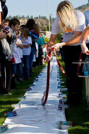 The longest fruit snack measured 91.44 m (300 ft) and was prepared by Sun-Rype Products Ltd (Canada) at the Parkinson Recreation Centre, Kelowna, B.C., Canada, on 16 October 2011.   All rights reserved Guinness World Records
