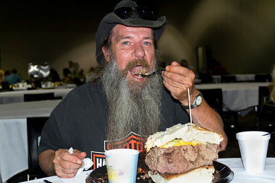 The largest hamburger weighed 913.54 kg (2,014 lb) and was prepared by Black Bear Casino Resort (USA), Carlton, Minnesota, USA, on 2 September 2012.  All rights reserved Guinness World Records