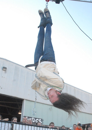 The fastest escape from a straitjacket and chains while suspended is 10.6 seconds and was achieved by Lucas Wilson (Canada), at Holy Trinity Catholic High School in Simcoe, Ontario, Canada on 8 June 2012.  All rights reserved Guinness World Records