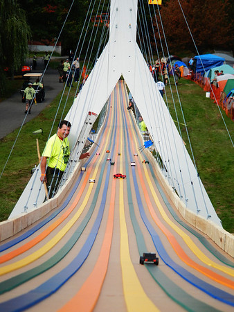 The longest pinewood derby track measured 97.54 m (320 ft) and was built by the Boston Minuteman Council and Boy Scouts of America (USA) in Boston, Massachusetts, USA, on 7 October 2012.  All rights reserved Guinness World Records