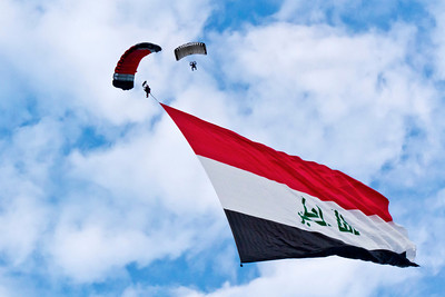 Fareed Lafta (Iraq) flew an Iraq flag measuring 4,023.2 m² (43,305.36 ft²) whilst parachuting over the Skydive Chicago facility in Ottawa, Illinois, USA, on 15 August 2012.  All rights reserved Guinness World Records
