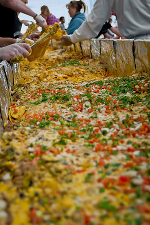The largest serving of nachos weighed 2,126.89 kg (4,689 lb) and was achieved by Centerplate at University of Kansas (USA) in Lawrence, Kansas, USA, on 21 April 2012.  All rights reserved Guinness World Records