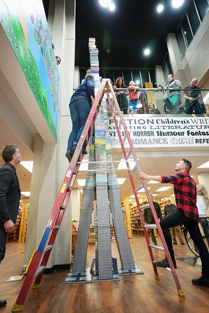 The tallest tower of Guinness World Records books is 6 m (19 ft 8.22 in), and was achieved by Russell Books (Canada) in Victoria, British Columbia, Canada, on 14 November 2019.