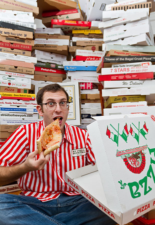 The largest collection of pizza boxes belongs to Scott Wiener (USA) and consists of 595 different boxes as of 23 October 2013, in New York City, New York, USA.  All rights reserved Guinness World Records