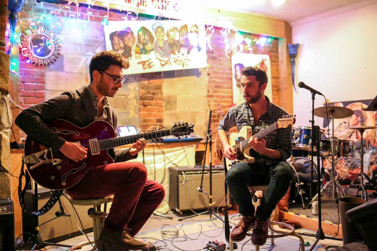 Guitarists Mike Bono and Jackson FitzGerald entertain at DownRight Music and Art in Collinsville. <br /> Photo by John Fitts