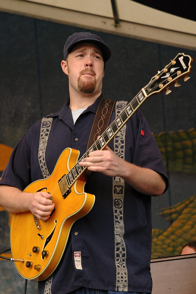 Eric Krasno (Soulive) performing live onstage with Robert Randolph & The Family Band at the New Orleans Jazz & Heritage Festival on May 6, 2006.