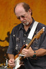 Paul Barrere performing live onstage with Little Feat at the New Orleans Jazz & Heritage Festival on May 5, 2006.