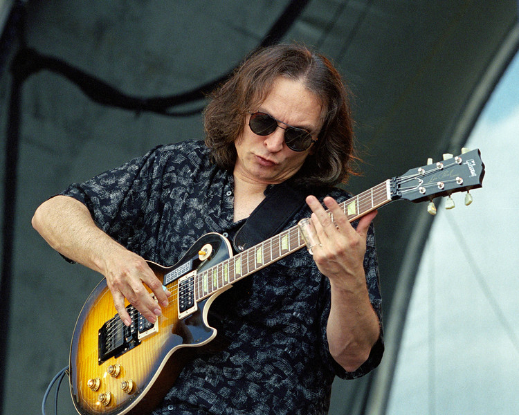Sonny Landreth performs with John Hiatt at the New Orleans Jazz & Heritage Festival on May 5, 2000.