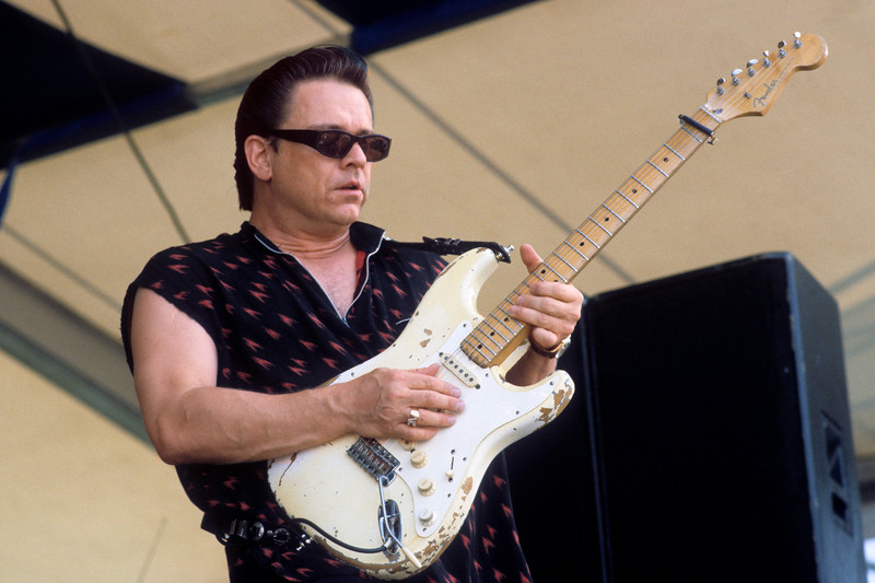 Jimmie Vaughan performs at the New Orleans Jazz & Heritage Festival on May 6, 1995.