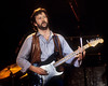"Eric Clapton performing at the Cow Palace on February 7, 1983. Eric was on his ""Money & Cigarettes"" tour."