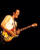"""Todd Rundgren performing live with Utopia on the Oblivion Tour at Pier 84 in New York City on August 24, 1984. Todd is playing the Gibson SG guitar originally owned by Eric Clapton and painted by """"The Fool."""""""