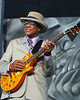 Hubert Sumlin performs in the Blues Tent as part of the Howlin' Wolf Tribute at the New Orleans Jazz & Heritage Festival on April 28, 2005