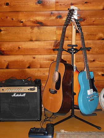 (Guitars counterclockwise from left): Takamine 12-String, First Act Lola, Hofner Macca Bass Copy; Marshall MG Combo Amp