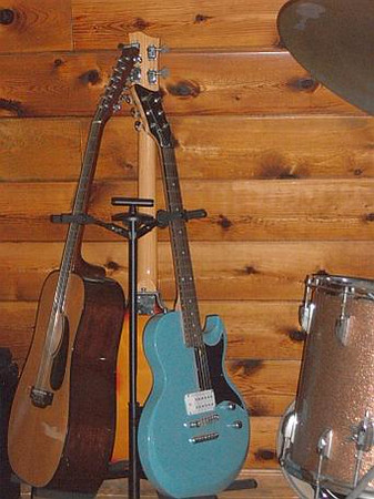 (Counterclockwise from left): Takamine 12-String, First Act Lola, Hofner Macca Bass Copy