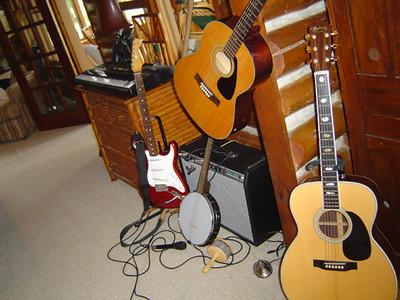 1987 Fender Stratocaster, Harmony Banjo, 1977 Yamaha FG-325, 1992 Martin J-40, 1973 Fender Deluxe Reverb