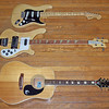 (Top to bottom): 1975 Fender Stratocaster, 1978 Rickenbacker 4001 with Ric-O-Sound, 1972 or 1973 Epiphone FT-350BL El Dorado