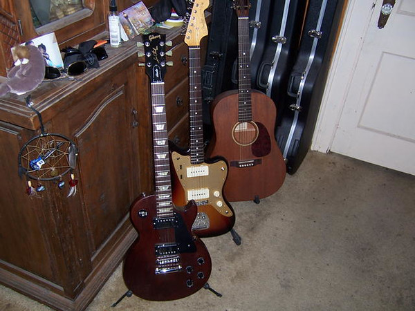 Gibson Les Paul Studio, Fender '59 Thinskin Jazzmaster Reissue, and unknown acoustic