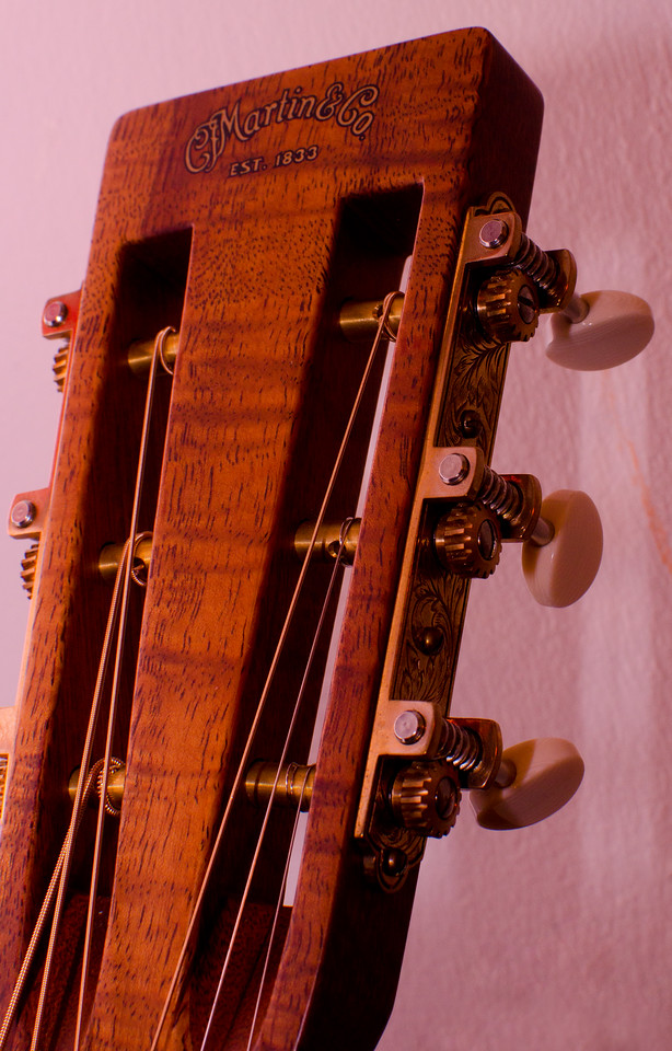 The Mahogany neck and Koa head plate have a satin finish.
