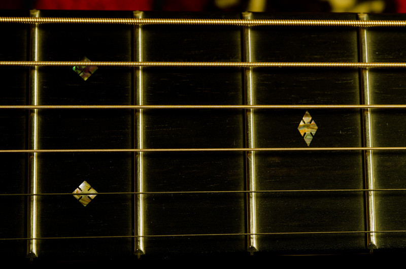 "Pearl fret marker inlays in the ""diamonds and squares"" pattern."