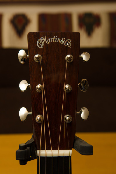 Paddle headstock with Madagascar rosewood head plate and Waverly tuning machines.  The C. F. Martin & Co. logo is inlaid in mother-of-pearl.