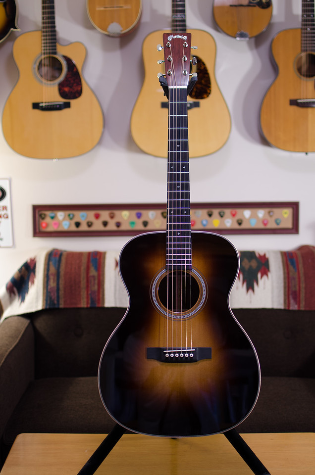 My concept was to merge features of my 3 favorite Martins.  The 14-fret 000 deep-body came from the OM-30DB Pat Donohue.  The Madagascar rosewood body and Carpathian Spruce top, plus the short scale-length and the pearl herringbone rosette came from the 000-28M Eric Clapton.  And the styling of the headstock, with the Martin logo in pearl, plus the wooden bindings and the fancy fingerboard inlays, came from my America's Guitar 175th Anniversary dreadnaught.