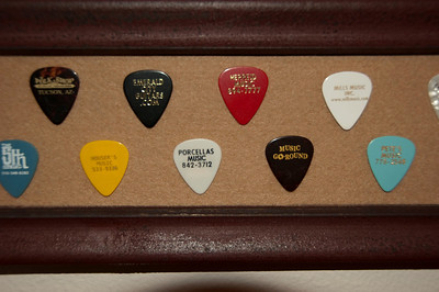 I've been collecting store picks for years, though I seem to have lost a few along the way.  The oldest one on the board was collected in 1997 at Bounty Music in Maui. I bought a mahogany tenor ukulele that day.  The uke has self-destructed, but I still have the pick.