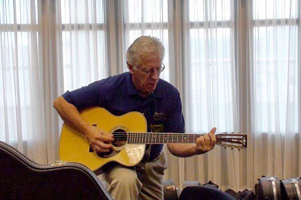 Dick Boak of Martin tries out my OM-30 Pat Donohue at Martinfest in 2008.