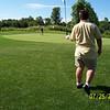 gc04c008_kurncz_pitches_3rd_shot_on_13th_hole_huntmore_072504