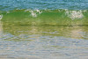 Clear emerald green, see the ripples in the sand