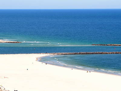 TURQUOISE PLACE balcony view looking East - these are the jetties at Perdido Pass