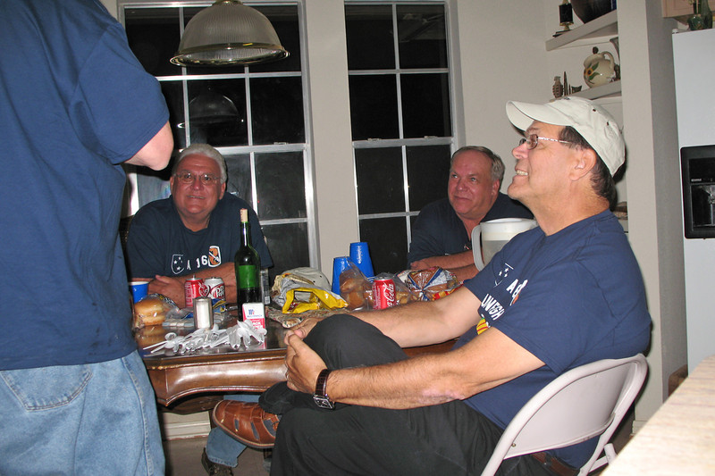 TR07-28: John Carlson, Don Kaiser, and Jim Turner at the dinner/discussion table.