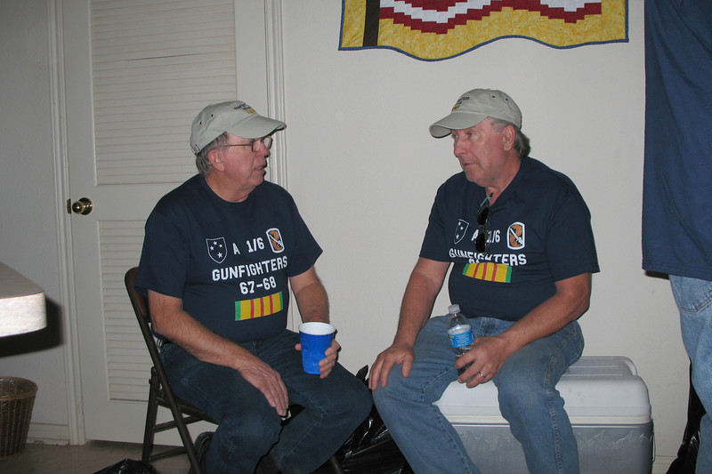 TR07-27: Tommy Folely (TX), 2nd platoon, and Joe Gamache (RI), HQ, guard the beer cooler.