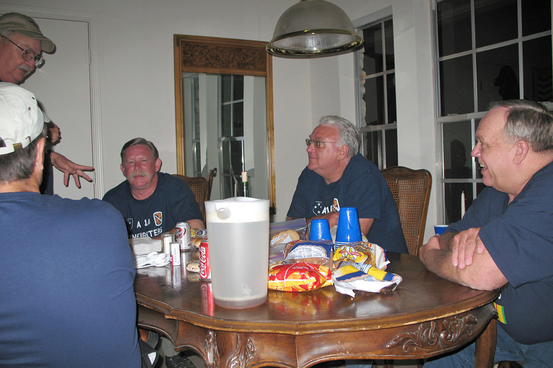 TR07-26: Harry Thompson (TX), HQ, Alan Allen (TX) and John Carlson (NJ) of 1st platoon, and Don Kaiser (TX), 3rd platoon, at the dinner/discussion table.