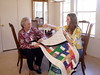 08MR-04: Geraldene Allen, Alan Allen's mom, and Maggie, his daughter, inspect a quilt Maggie just finished. The quilt may go to Alan's granddaughter, Riley, who is expected in early March 2009, by Nathan (Alan's son) and his wife, Shauna. They all live in Austin, TX, except Geraldene, who still lives in Allentown, TX.