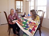 08MR-05: Geraldene Allen, Alan Allen's mom, and Maggie, his daughter, inspect a quilt Maggie just finished. The quilt may go to Alan's granddaughter, Riley, who is expected in early March 2009, by Nathan (Alan's son) and his wife, Shauna. They all live in Austin, TX, except Geraldene, who still lives in Allentown, TX.