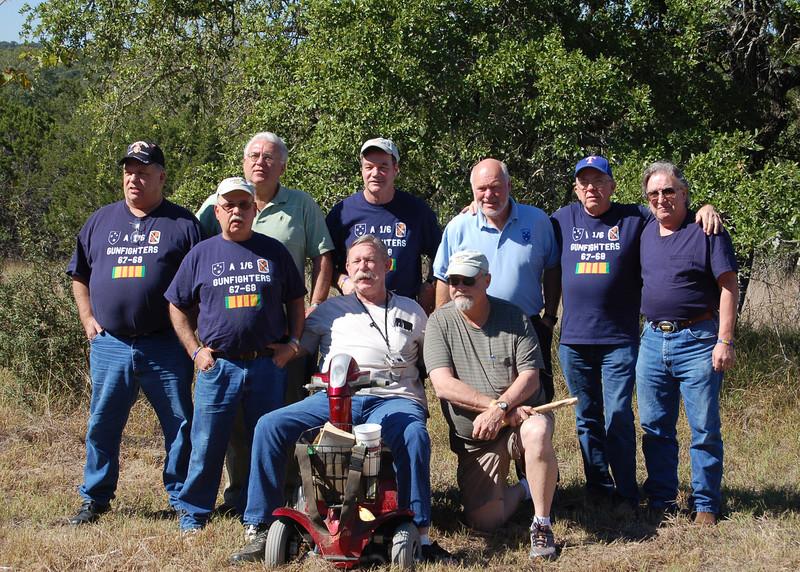 "08MR-03: Standing: Don Kaiser (TX, 3rd Plt), Paul ""Bear"" Senick (PA, 1st Plt), John ""Chunky"" Carlson (NJ, 1st Plt), Larry Boetsch (NJ, 1st Plt), Terry Buelow (IA, 2nd Plt), Tommy Foley (TX, 2nd Plt), and Joe Gamache (RI, HQ). Resting are Alan Allen (TX, 1st Plt) and Harry Thompson (TX, HQ)."
